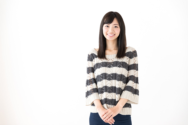 portrait of young asian woman relaxing on white background