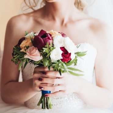bride-with-flowers-HH23SYM