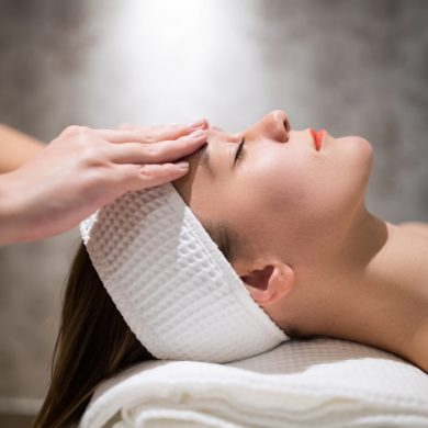 Facial massage treatment by professional at cosmetics saloon
